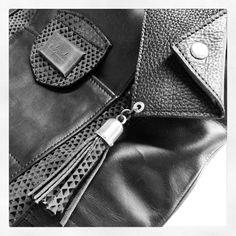 Adorada carteras. Tote and purse. Details black leather.