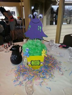 Mommy's Little Monster Baby Shower centerpiece on the table