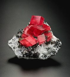 Rhodochrosite (red), with tetrahedrite (bluish), quartz (white), 8 cm tall // Sweet Home Mine, Alma, Park County, Colorado // Bryan and Kathryn Lees collection, Kevin Dixon photo      mw