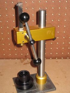 Reloading Press by M700 -- Homemade reloading press constructed from an arbor press and commercially available dies. http://www.homemadetools.net/homemade-reloading-press-3