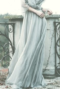 Love the scrolls and leaves in the background, with the pale colors, long flowy dress. Details.