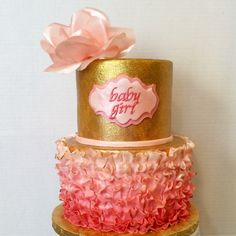 Sparkling gold baby shower cake with pink ombre fondant ruffles and wafer paper rose by A Piece of Cake