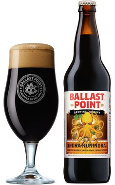 """Ballast Point - Indra Kunindra Curry Export Stout """"A burst of Madras Curry, Cumin, Cayenne, Coconut, and Kaffir Lime Leaf. Enjoy! Our India-style Export Stout is a unique collaboration with award-winning homebrewer Alex Tweet. Released in limited quantities, this explosion of South Asian flavors is reason enough to kneel down and thank the heavens. It's further proof of San Diego's status as a brewer's playground, and a beer lover's utopia.""""   7% ABV   50 IBUs"""