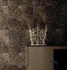 A sequel to Natives, 8 new designs with a warm feel. The panther , the zebra  and the lion are the lords of Africa where we begin our collection. Somewhere between lynx and leopard, this is a superb fur. http://www.elitis.fr/en/fabric/collection-memoires-203/drawing-panthere-134#.VGzF2_mG91Y #elitis, #wallpaper, #panthere, #animal