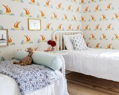 A whimsical children's room makes use of Katie Ridder's Beetlecat wallpaper.