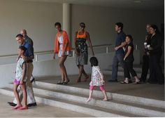 President Barack Obama walks with his daughter Sasha after a visit to the East-West Center at the University of Hawaii January 1, 2012 in Honolulu. From 3rd left: The President's daughter Malia, wife Michelle, niece Savita Ng, brother-in-law Konrad Ng with his daughter Suhailia, and sister Maya Soetoro-Ng.