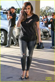 kim kardashian bares cleavage in black cut out shirt 13 Kim Kardashian sports a cut out t-shirt while filming scenes for her hit reality show Keeping Up with the Kardashians at Maria's Italian Kitchen on Friday (February…