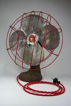 Take 1 plain Jane vintage fan, replace the cord + plug with something like this!  Spray paint the grill red and voila.  Grooviness ensues.  Cloth-covered 18/2 Red Cotton Twisted Wire