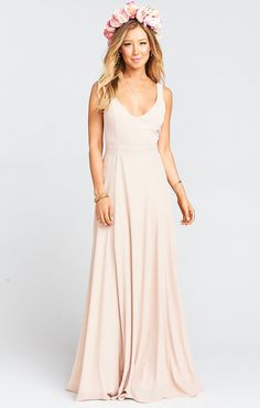 A guide on how to get the look of mismatched neutral bridesmaid dresses, with neutral dresses in cream, champagne, taupe, gold, and sequins to choose from.