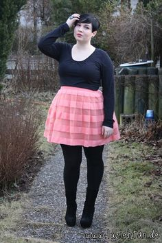 I'm going to try this, too: black top and stockings and shoes with a femmie skirt.