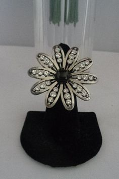 Vintage Rhinestone Statement Ring Size 7 with a Black Cabachon Center Stone in a Floral Motif and set in silvertone metal. Free Shipping to the US and 15% off with a coupon code 03012016. Priced at $16.00. See more photos at www.CCCsVintage jewelry.com and check out our new listings. There are many new rhinestone items.  And you can use the 15% off and free shipping on this $16.00 ring.