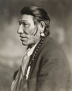 An old photograph of a Blackfoot Indian.