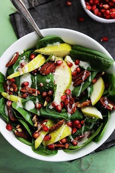Fresh spinach salad topped with pomegranate seeds, crisp pears, crunchy pecans, feta cheese, and creamy poppyseed dressing.