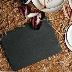 Slate Placemat (West Elm).  Just add some chalk and it is perfect for keeping the kiddos entertained at the table!