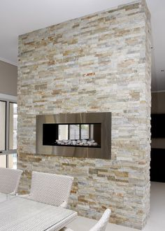 Color of stacked stone: #CamelotHomes Bridgewater Project | stacked stone fireplace by Home Fires.