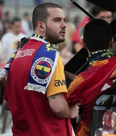 Soccer & Politics: Turkish resisters wear rival teams scarves with soccer jerseys to show unification. We Are The Champions, The Rival, Watch V, Twitter, National Geographic, Trending Memes, Latina, Baseball Cards, Sports