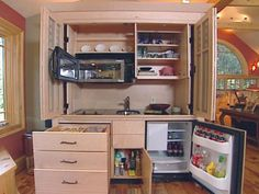 Find out why one family had a fully functional kitchen hidden inside a large custom-built cupboard.
