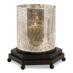 IMAX CK Jupiter Glass Votive Hurricane - 12719. IMAX CK Jupiter Glass Votive Hurricane - 12719 The Jupiter glass votive hurricane holds multiple votive candles inside broken silvered glass to light up these shapes and textures in a fresh, contemporary way. Holds votive can.. . See More Candle Holders at http://www.ourgreatshop.com/Candle-Holders-C735.aspx