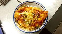 Katsudon Chicken katsu donburi serve with pouched egg , teriyaki sauce and slices grilled onion