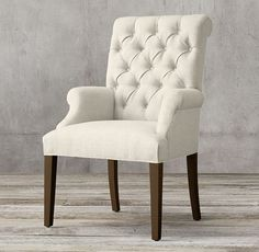 RH's Bennett Roll-Back Fabric Armchair:Defined by its graceful curves and elegant silhouettes, Georgian furniture stands in refreshing contrast to the Victorian designs that followed it. Our dining chair captures that lighter outlook with its high tufted back and refined proportions. Deeply cushioned and generously sized, it's a comfortable spot for dining and conversation.