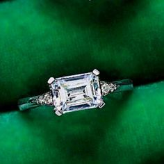 I love love love the horizontal emerald cut rings! But rose gold & a pink saphire/ pink moissanite stone!