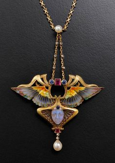 Philippe Wolfers Nike Enamel Ruby Emerald Diamond Gold Pendant. Pendant « Niké » Gold, enamel, rubies, emeralds and diamonds Brussels, 1902