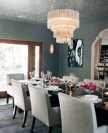A sixties Murano-glass chandelier adorns Jessica Alba's dining room..... love colour of walls