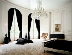 Lenny #Kravitz Paris apt bedroom black white fur glam chandelier 1970s chair