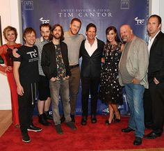 Heidi Leigh, Imagion Dragons bass guitarist Ben McKee, drummer Daniel Platzman, guitarist Daniel Wayne and singer Dan Reynolds pose for a photo with artist Tim Cantor, Amy Cantor, Rick Harrison and Chad Sampson at Tim Cantor's Las Vegas art exhibit at AFA Gallery (Photo credit: Denise Truscello / WireImage).