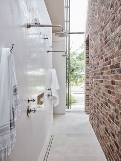 At Home With Chrissie Rucker, Founder of The White Company Tadelakt and brick walls contrast each other in this pool house shower design. The White Company, Alice Coltrane, Pool Shower, Tadelakt, Wet Rooms, Maine House, Pool Houses, Bathroom Interior, Bathroom Inspiration