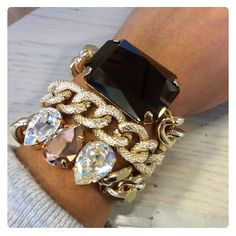 Stacked bracelets. Love the largeness.