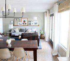 love all the texture and layers - a sun-drenched living space that feels cozy and authentic