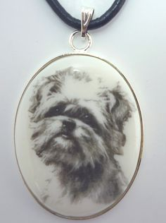 A Brussels Griffon Drawing on White Cabochon in Silver Tone Pendant