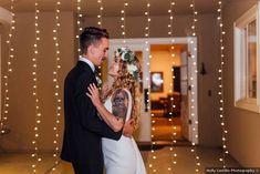 Wedding photography in front of thin hanging string lights; boho bride donning flower crown
