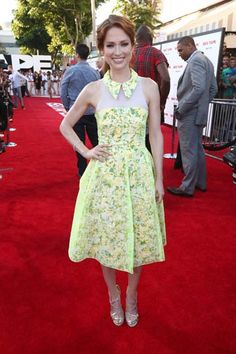 Actress Ellie Kemper attended the premiere in a neon yellow floral Honor dress.