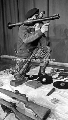 British Army officer demonstrates a Russian RPG7 rocket launcher, part of an arms haul uncovered by 1 Bn Queen's Regiment in the New Lodge d...