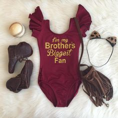 "Instagram @dailythreads_ Featuring our ""I'm my Brother's Biggest Fan"" Burgundy Flutter sleeve Leotard in gold glitter design!✨ (Note: Please indicate at check out if you'd like it to say ""Daddy's""/""Sisters""/a name/or something else! Feel free to message me on Etsy with any questions!) TheDailyThreads.etsy.com #ImMyBrothersBiggestFan #Fan #cheer #biggestfan #bigfan #cheerleader #baseball #basketball #soccer #football #leotard #dance #dancer #gymnastics #gymnast #brother #sister #daddy"
