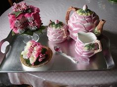 The tea tray is a always a perfect centerpiece because there is an endless selection of teapot styles. Add a fake cake that you make yourself from silk florals.
