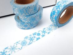 This washi tape is white with blue snowflakes on it. There are lots of different style snowflakes in various sizes. It will make a fun and whimsical addition to your winter decorations. Fun to use in scrapbooks, mixed media art, paper crafts, and card making. Or decorate your office tools or school supplies. Washi tape can be easily torn by hand and can be written on. Use it to label items or to leave a quick note. Great for Christmas cards and gift wrap.  This is for one roll: 15mm x 10m…