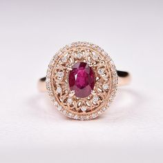 Hand Crafted in 14K rose gold this Vintage style ring is 16x14mm, It holds a beautiful Oval shaped 7.1x5.2mm 1.22 carat natural Ruby in the center