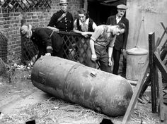 September, A huge unexploded land mine lies in a back garden of a house in a London suburb; they are being dropped by parachute from enemy planes (Photo by Popperfoto/Getty Images) London History, British History, Women In History, World History, Land Mine, Old London, Blitz London, The Blitz, London Pictures