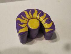 Creator's Joy: Tangled Sun Motif Polymer Clay Cane
