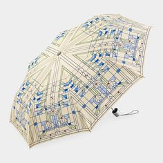 """The Frank Lloyd Wright Waterlilies Mini Umbrella is a both practical and decorative accessory (38"""" span). Design adapted from an unrealized art glass design(1893)."""