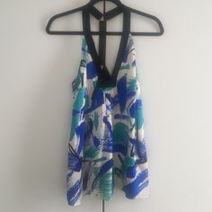 NEW Alice & Trixie 100% SILK halter top No tags but never been worn beautiful brush stroke printed 100% silk halter top.  Subtle pleat at front neck-line (low V).  Back is different and special with grosgrain straps, a T-back & hardware. Alice & Trixie Tops Tank Tops
