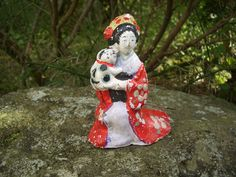 Japan antique clay doll a woman wore beautiful kimono with cat