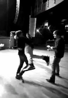 Things happening in this gif: Niall skipping through a field of hardwood floor, Daddy Direction walking backwards making sure Harry doesn't fall and.... Louis kidnapping his 'lover'