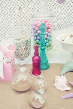 use plastic leftover craft ornaments as bubbles {Our fuchsia vintage glass bottle is super cute, too!}