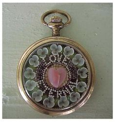All the items on this link are gorgeous:  Shells mounted in old pocket watch case