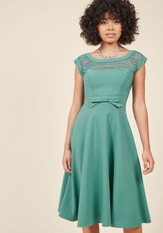 <p>If you're going to give your most coquettish expression, you might as well lend it as an accessory to this mint dress! Made stunning from a bateau neckline detailed with geometric lace, a waistline bow, and a swingy midi skirt touched with stretch, this retro darling - a ModCloth exclusive - embodies sophistication with a hint of flirtation.</p>