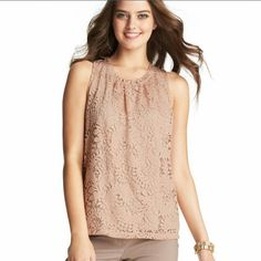 LOFT Lace Top Lavishly done in allover lace, this bombshell beauty- with a ruffle at the neckline for a little extra romance- is our take on modern vintage pretty. Jewel neck. Sleeveless. Gathered beneath neckline. Keyhole detail at back with button closure.  Sleeveless with no damage. 60% cotton and 40% Modal. Machine washable.  Offers accepted ➡Please be considerate of Poshmark's 20% fees ❎Sorry, no trades LOFT Tops